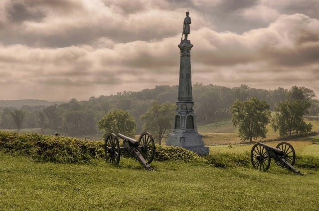 "The ""High Water Mark"" on Cemetery Ridge as it appears today. The monument to the 72nd Pennsylvania Volunteer Infantry Regiment (""Baxter's Philadelphia Fire Zouaves"") appears at right, the Copse of Trees to the left."