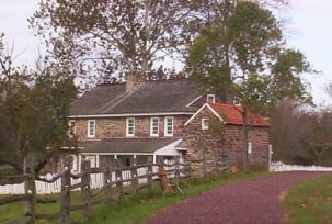 Features the restored house and barn, furnished with antiques, furniture, tools, and farm equipment.